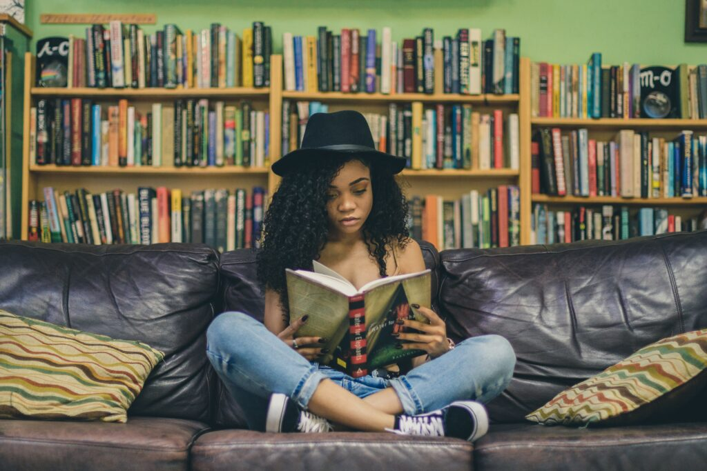 millennial, young woman reading a book to show millennial interest in print marketing